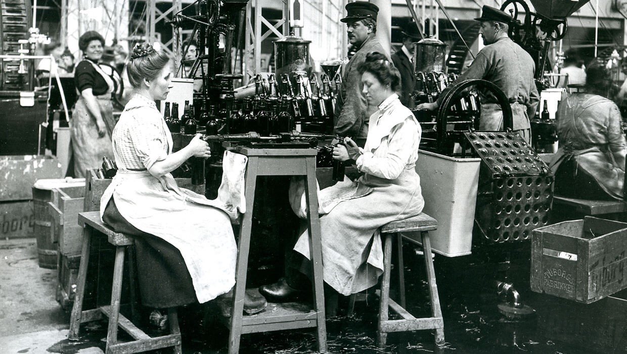 Woman working in Turbogs brewery at an assembly line to ensure beer bottle quality