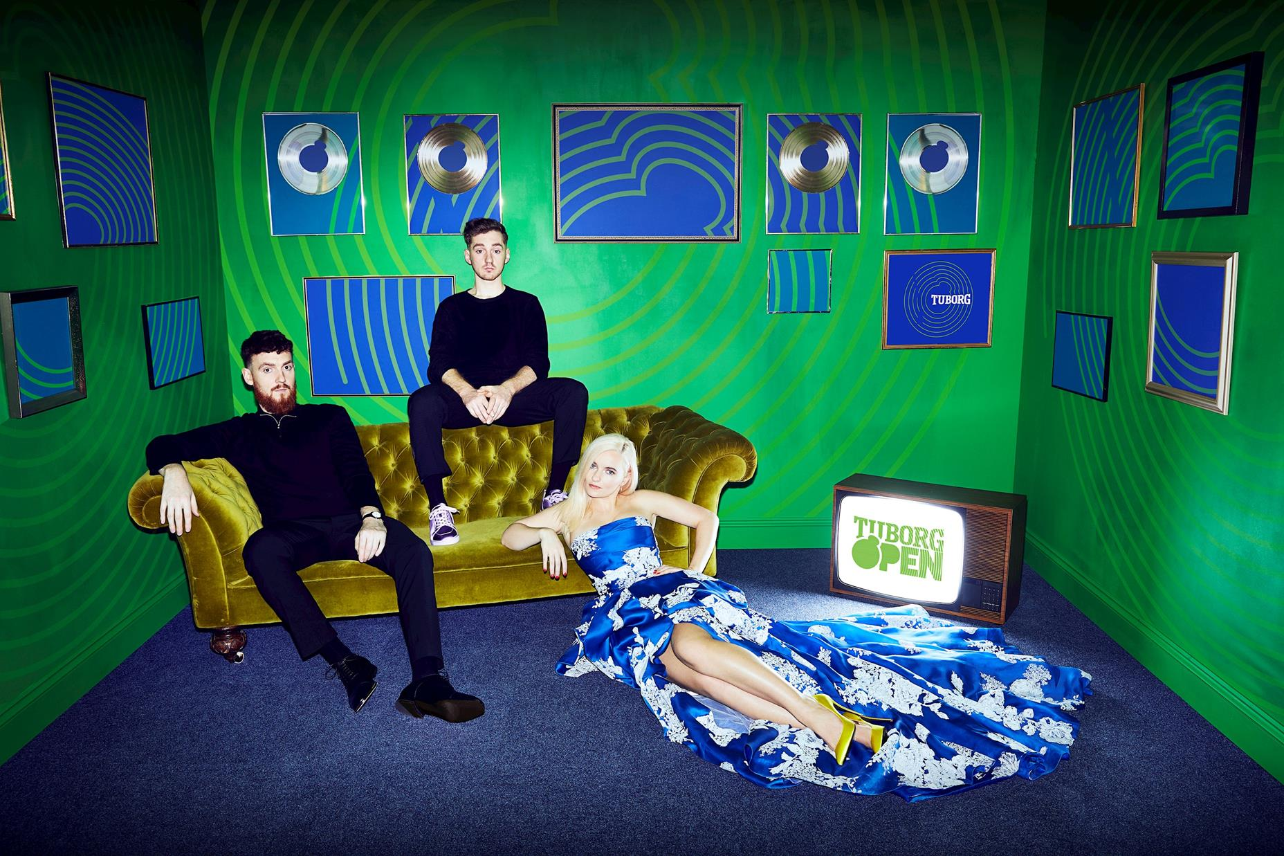 clean bandit band on sofa at a sofatable
